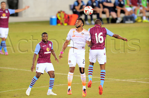 26.07.2014. Houston, Texas, USA.  Houston Dynmao  forward Giles Barnes battles Fabian Delph(16) for a header as Charles N'Zogbia looks on during Houstons 1 - 0 loss to Aston Villa at BBVA Compass Stadium in Houston, TX.