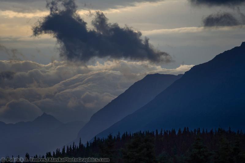 Clouds move over the mountains bordering Naknek lake, Katmai National Park, Alaska.
