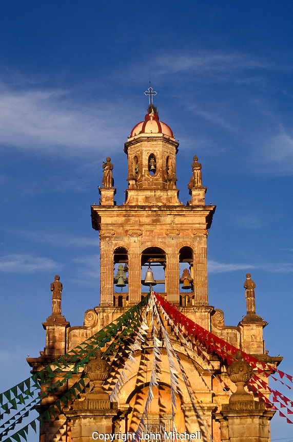 The Templo El Santario steeple decorated with red white and green streamers for the Dia de la Revolucuion (November 20) celebrations, Patzcuaro, Michoacan, Mexico