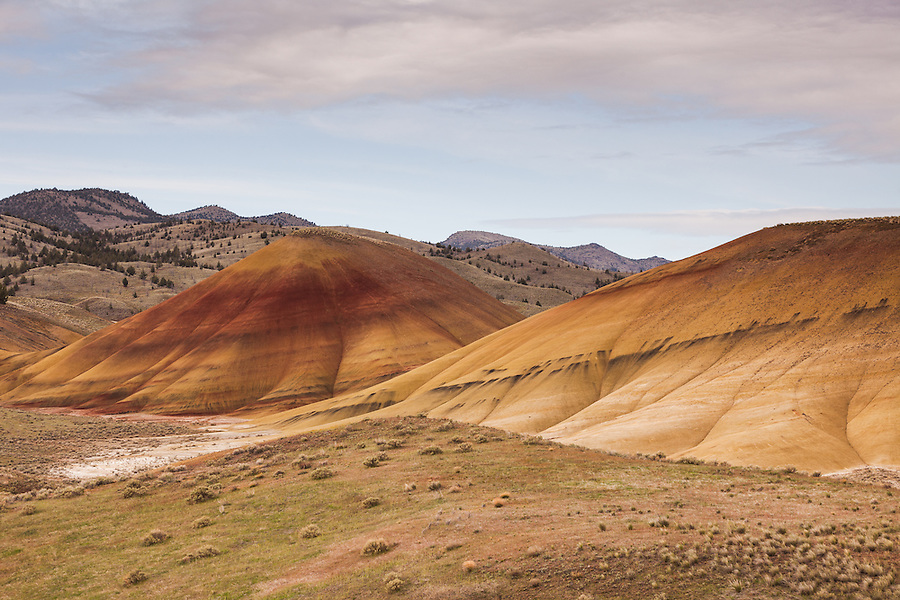The Painted Hills area of the John Day Fossil Beds National Monument is seen under a cloudy blue sky in Wheeler County, Oregon.