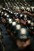 Recruits belonging to the New York Police Department's Class of 2005 attend their graduation ceremony, 29 December 2005, in New York City. About 20% of the 1,735 recruits sworn in during the ceremony are female.