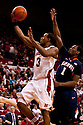 18 February 2012: Brandon Richardson #3 of the Nebraska Cornhuskers makes a lay up against D.J. Richardson #1 of the Fighting Illini during the second half at the Devaney Sports Center in Lincoln, Nebraska. Nebraska defeated Illinois 80 to 57.