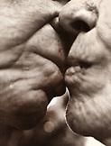 USA, California, senior couple in love kissing in La Jolla (B&W)