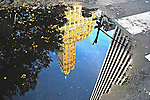 Reflection in water on Fifth Avenue, Manhattan, New York City.
