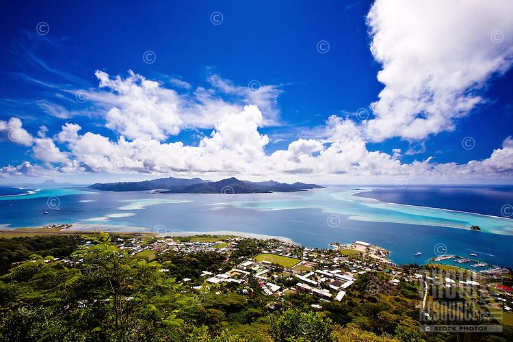 View of Tahaa island, Uturoa Harbor, pass, and surrounding reefs from Mount Tapioi on Raiatea island