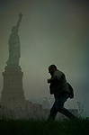 Man running near the statue of Liberty