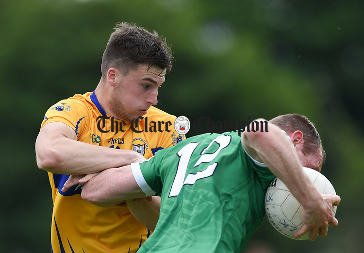Jamie Malone of Clare in action against Garrett Noonan of Limerick during their Munster championship quarter-final game in Cusack park. Photograph by John Kelly.