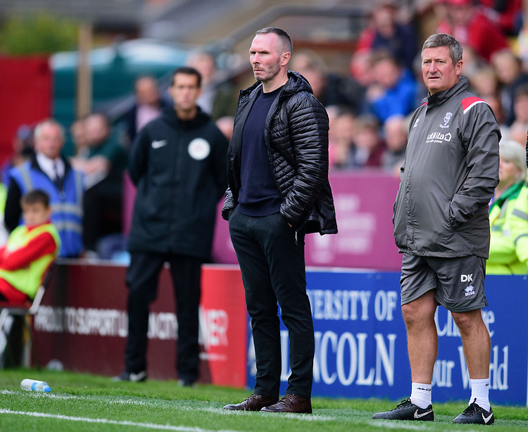 Lincoln City manager Michael Appleton, left, and Lincoln City's assistant manager David Kerslake in the technical area<br /> <br /> Photographer Andrew Vaughan/CameraSport<br /> <br /> The EFL Sky Bet League One - Lincoln City v Sunderland - Saturday 5th October 2019 - Sincil Bank - Lincoln<br /> <br /> World Copyright © 2019 CameraSport. All rights reserved. 43 Linden Ave. Countesthorpe. Leicester. England. LE8 5PG - Tel: +44 (0) 116 277 4147 - admin@camerasport.com - www.camerasport.com