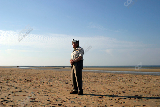 Former American soldier Leo Jereb (Cleveland, OH) stands on Utah Beach, where he landed 60 years before in the D Day invasion of June 6, 1944.  June 6, 2004..Normandy, France.