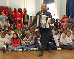 Ramon Mora of Freeport, a volunteer, plays an accordian and leads students in singing Latin Songs during festivities celebrating the last day of Hespanic Hertiage Commemoration at Franklin Elementary School in Hempstead on Wednesday November 2, 2005. (Newsday Photo / Jim Peppler).
