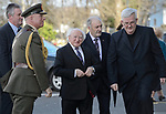 The President Michael D. Higgins arrives and is accompanied by Col. Michael Kiernan, Bernard Finan, NUIG, and Mons. Michael Mc Loughlin  for the the funeral of Bishop Eamonn Casey at Galway cathedral. Photograph by John Kelly.