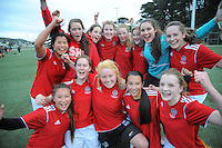 The Sacred Heart team celebrate winning the Wellington girls college football bronze playoff final between Sacred Heart College (red) and Wellington High School (green and gold) at Wakefield Artificial Turf,  Wellington, New Zealand on Wednesday, 21 August 2013. Photo: Dave Lintott / lintottphoto.co.nz