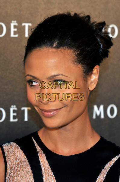 THANDIE NEWTON .Moet & Chandon hosts a Tribute to Cinema at Big Sky Studios, Brewerey Road, London, England, UK, .25th March 2009..and et portrait headshot black beige hair up .CAP/PL.©Phil Loftus/Capital Pictures
