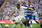 Swansea's Ashley Williams is tackled by Reading's Noel Hunt during the Npower Championship play-off final between Reading (blue) and Swansea City at Wembley Stadium. The match was won by Swansea by 4 goals to 2 watched by a crowd of 86,581. Swansea became the first Welsh team to reach the top division of English football since they themselves played there in 1983.