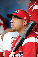 Batavia Muckdogs catcher Jose Ceballos (32) in the dugout during a game against the Williamsport Crosscutters on August 16, 2013 at Dwyer Stadium in Batavia, New York.  Batavia defeated Williamsport 5-2.  (Mike Janes/Four Seam Images)