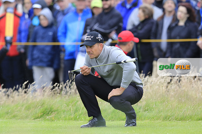 Henrik Stenson (SWE) lines up his putt on the 2nd green during Saturday's Round 3 of the 145th Open Championship held at Royal Troon Golf Club, Troon, Ayreshire, Scotland. 16th July 2016.<br /> Picture: Eoin Clarke | Golffile<br /> <br /> <br /> All photos usage must carry mandatory copyright credit (&copy; Golffile | Eoin Clarke)