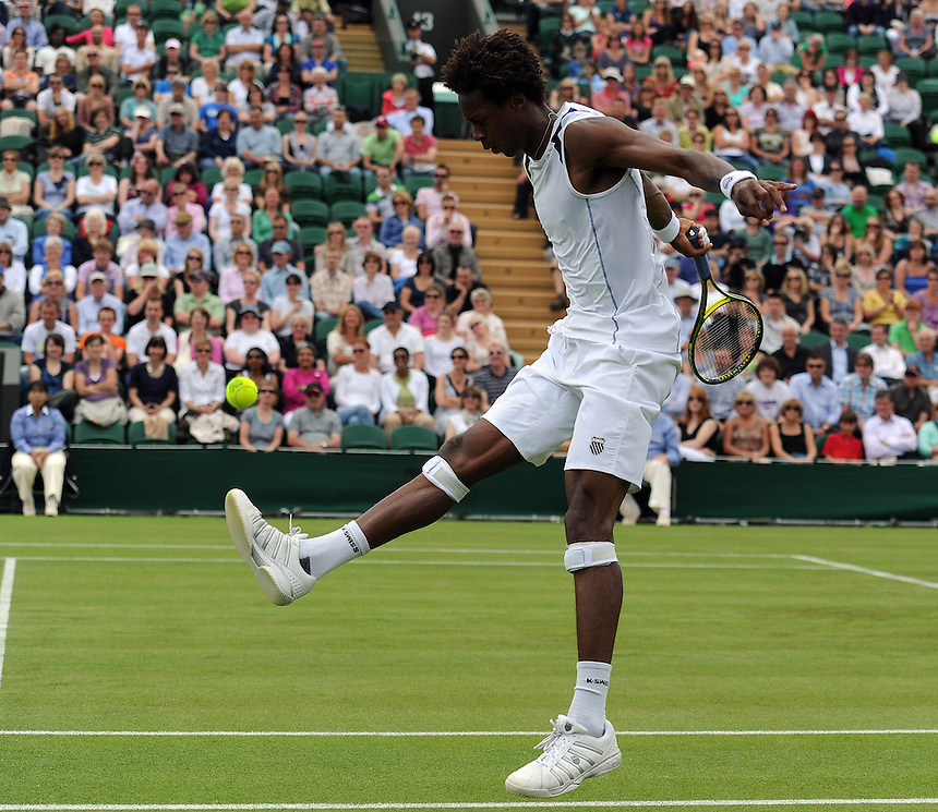 Gael Monfils (FRA) shows his football skill during his victory over Matthias Bachinger(GER) in todays first round match - Gael Monfils(FRA)[9] def Matthias Bachinger(GER) 6-4 7-6(3) 6-3...