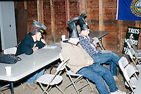 From left, Alan Clement, Damian Thorne, and Nick Belisle, all of Rochester, NH, watch as satirical presidential candidate Vermin Supreme speaks at Ten Rod Farm in Rochester, New Hampshire. The three said they are supporters of Vermin Supreme. Supreme's platform advocates a pony-based economy, using zombies to solve the energy crisis, and other outlandish ideas. Supreme has been on the New Hampshire primary ballot in 2008 and 2012, though he began running for president in 1992. Vermin Supreme will be on the Democratic party ballot in the 2016 New Hampshire primary.