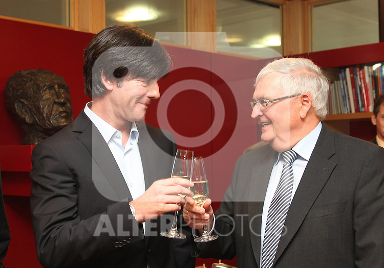 15.03.2011, DFB Zentrale, Frankfurt, GER, Vertragsunterzeichnung von Bundestrainer Joachim Löw (Loew), im Bild  German football national coach Joachim Loew (L) and the president of the German Football Association (DFB) Theo Zwanziger click their glasses after Loew signed a contract , signs a contract at the DFB headquarters     Foto © nph / Orlowski