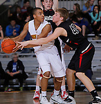RAPID CITY, S.D. -- March 20, 2014 -- Evan Greeneway #40 of Yankton reaches on Chris Phillips #3 of Sioux Falls Roosevelt during their opening round game at the 2014 South Dakota State AA Boys Basketball Tournament at the Barnett Arena in Rapid City Thursday. (Photo by Dick Carlson/Inertia)