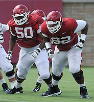 NWA Democrat-Gazette/ANDY SHUPE<br /> Arkansas offensive linemen Johnny Gibson (62) and Josh Allen work through a drill Tuesday, Aug. 11, 2015, during practice at the university's practice field in Fayetteville.