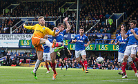 Jason McCarthy of Wycombe Wanderers hits a shot at goal during the Sky Bet League 2 match between Portsmouth and Wycombe Wanderers at Fratton Park, Portsmouth, England on 23 April 2016. Photo by Andy Rowland.