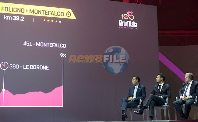Defending Champion Vincenzo Nibali, Fabio Aru and Race Director Mauro Vegni on stage at the 100th edition Giro d`Italia 2017 route presentation held at the Ice Palace in Milan, 25th October 2016.<br /> Picture: ANSA/Claudio Peri | Newsfile<br /> <br /> <br /> All photos usage must carry mandatory copyright credit (&copy; Newsfile | ANSA/Claudio Peri)