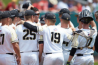 Cam Opp (19) of the Army Black Knights puts is arm around teammate Matt Gray (25) prior to the game against the North Carolina State Wolfpack at Doak Field at Dail Park on June 3, 2018 in Raleigh, North Carolina. The Wolfpack defeated the Black Knights 11-1. (Brian Westerholt/Four Seam Images)
