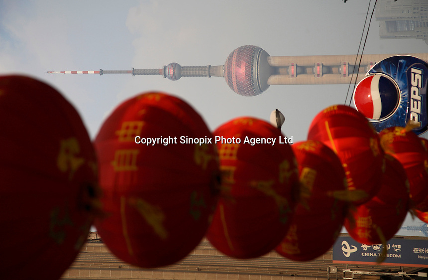 The Oriental Pearl TV Tower seen with decorative balloons in Shanghai, China..