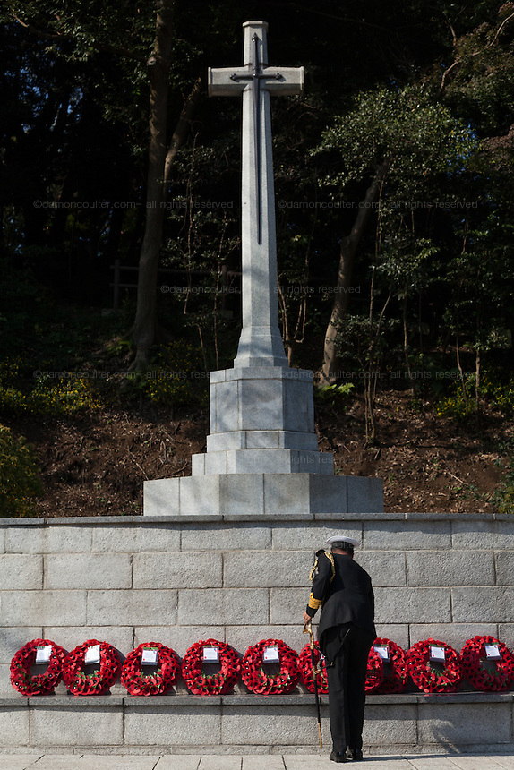 A military officer from lays a wreath during a ceremony for Remembrance Sunday at the Commonwealth War Graves Cemetery in Hodogaya, Yokohama, Japan. Sunday November 13th 2016. Each year representatives of the Commonwealth nations, along with American and other European nations that lost servicemen fighting the Japanese in World War 2, hold a multi-faith service of remembrance at this cemetery. This is the only cemetery for war dead in japan that is managed by the Commonwealth War Graves Commission.