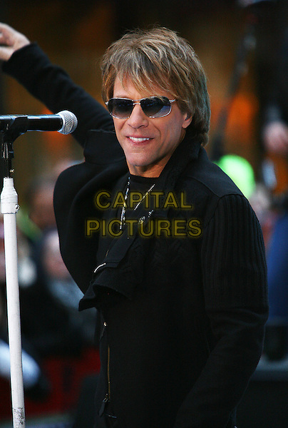 "JON BON JOVI.Bon Jovi perfroms live on NBC's ""TODAY"" Show, New York, NY, USA..November 12th, 2010.stage concert live gig performance music half length black coat sunglasses shades.CAP/ADM/PZ.©Paul Zimmerman/AdMedia/Capital Pictures."