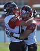 Brian Bornkamp #18 of Plainedge, left, gets congratuated by Zach Licata #14 after catching a pass for a touchdown in the first quarter of a Nassau County Conference III varsity football game against host Lawrence High School on Saturday, Sept. 23, 2017. Bornkamp made four touchdown receptions, including the game-winner with 23.3 seconds left in the fourth quarter, to lift Plainedge to a thrilling 38-34 win.