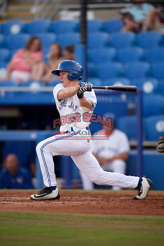 Dunedin Blue Jays right fielder Andrew Guillotte (1) follows through on a swing during a game against the St. Lucie Mets on April 19, 2017 at Florida Auto Exchange Stadium in Dunedin, Florida.  Dunedin defeated St. Lucie 9-1.  (Mike Janes/Four Seam Images)