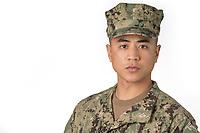 studio shot of man in US military uniform