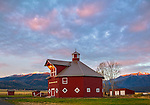 Wallowa County, OR: Octagonal barn of the Triple Creek Ranch at sunrise; Wallowa Valley with the Wallowa Mountains in the distance