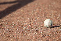 A Midwest League baseball sits on the warning track prior to the game between the Wisconsin Timber Rattlers and the Great Lakes Loons at the Dow Diamond on May 4, 2013 in Midland, Michigan.  The Timber Rattlers defeated the Loons 6-4.  (Brian Westerholt/Four Seam Images)