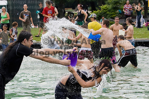 Public water fighting on the streets of Budapest, Hungary. Saturday, 22. August 2009. ATTILA VOLGYI