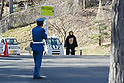 A zookeeper wearing a chimpanzee costume tries to escape during an Escaped Animal Drill at Tama Zoological Park on February 7, 2017, Tokyo, Japan. The annual escape drill is held in Tokyo zoos for zookeepers to practice how they would need to react in the event of a natural disaster or another emergency. This year a member of staff wearing a chimpanzee costume was captured and subdued by other zookeepers before it could escape out onto the streets of Tokyo. During the drill, participants used large nets, sticks and tranquilizer guns to make sure the monkey didn't get away. (Photo by Rodrigo Reyes Marin/AFLO)