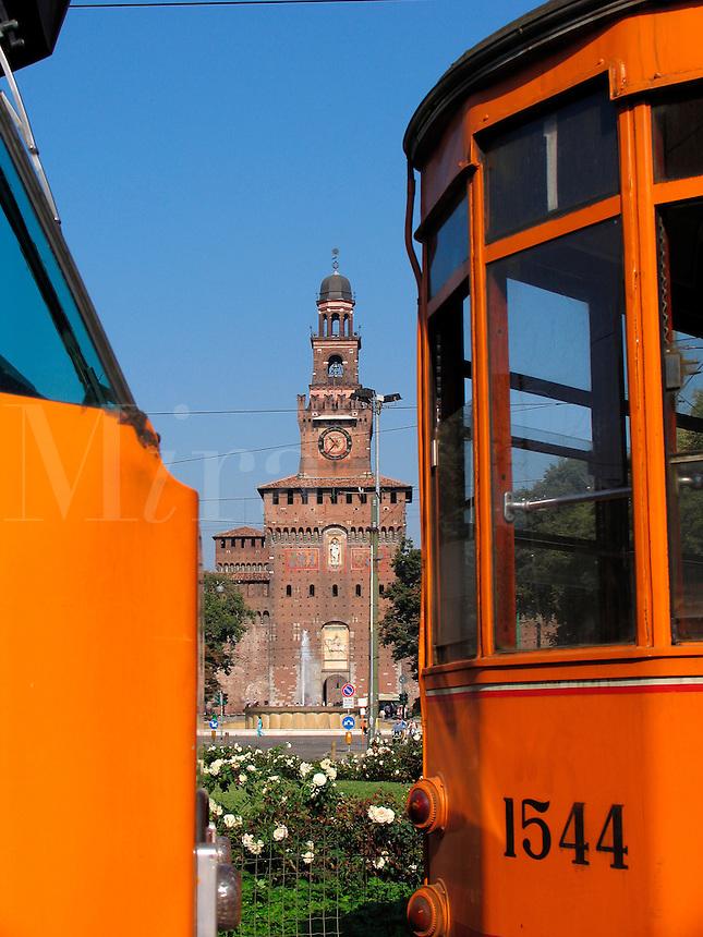 Sforza Castle, Milan, Italy view between two orange trolley car