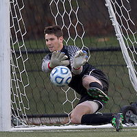Rutgers University goalkeeper Kevin McMullen (28) makes a stop during penalty kicks. Rutgers University defeated Boston College in penalty kicks after two overtime periods in NCAA Division I tournament action, at Newton Campus Field, November 20, 2011.