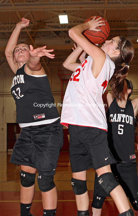 Litchfield, CT-120112MK01 Wolcott's Kayla Briere puts up a shot as Canton's Gabby Rose defends during the 8th annual Wamogo basketball jamboree on Saturday afternoon at Wamogo High School in Litchfield.  The teams played 30 minute games and rotated from the large and small gyms within the school.  Wamogo coach Kevin Crowley said that the teams enjoy the event and every year the schools come back to participate.  Michael Kabelka Republican-American