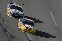 Apr 26, 2009; Talladega, AL, USA; NASCAR Sprint Cup Series driver Michael Waltrip (55) leads teammate David Reutimann (00) during the Aarons 499 at Talladega Superspeedway. Mandatory Credit: Mark J. Rebilas-