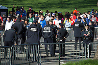 Police officers stands during the City Parks Foundation Run for the Parks in central Park New York, April 21, 2013. by Kena Betancur / VIEWpress