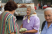 Peasant women sell agricultural produce at a market in Lublin.