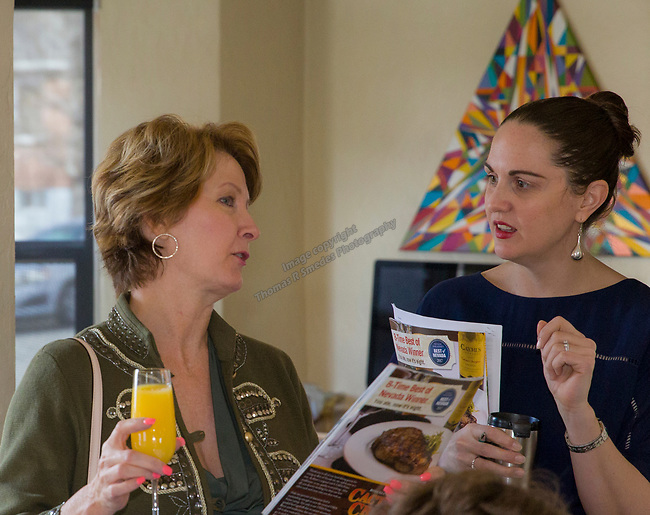 Reno Magazine editor Laura Longero, right, talks with guests during Reno Magazine's Home Decor Workshop at Aspen Leaf Interiors Studio in Reno on Saturday, March 24, 2018.