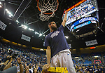 Nevada's Caleb Martin cuts down the net after their win over Colorado State for the Mountain West Championship in a NCAA college basketball game in Reno, Nev., Sunday, Feb. 25, 2018. (AP Photo/Tom R. Smedes)