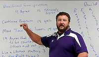 NWA Media/DAVID GOTTSCHALK - 12/18/14 - Ray Keller,  physical education teacher and head football coach,  discusses the results of  The R.E.A.L. Man program at with the participants at Oakdale Middle School in Rogers Thursday December 18, 2014. The character development program The R.E.A.L. Man program, respect all people, especially women, always do the right thing and live a life that matters,  taught by Ray Keller, a physical education teacher and head football coach, and Jeff Smith,  a history teacher and assistant football coach, was offered to eighth grade boys finished after 16 weeks with a recognition ceremony.