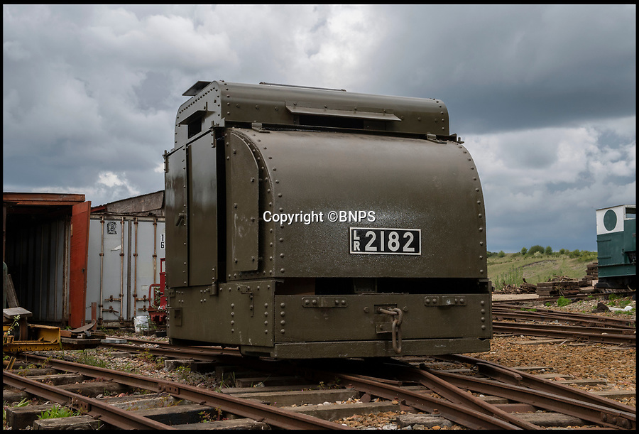 BNPS.co.uk (01202 558833)<br /> Pic: PhilYeomans/BNPS<br /> <br /> Old War Horse...back on track.<br /> <br /> The last surviving armoured locomotive used to pull munitions to the front line in World War One has been painstakingly restored a century later.<br /> <br /> Volunteers at the Greensand Trust based in Leighton Buzzard have spent the past decade bringing the historic Simplex 40HP engine back to full working order as part of a £20,000 project.<br /> <br /> The 8ft high, 10ft long loco, resembling a tank, was built in Bedford in 1917 and encased in full armour plating to protect it's plucky driver from enemy shell fire on the Western Front.<br /> <br /> It's petrol engine made it more discreet to use at night close to the front line than larger, noisier and more visible steam trains, which were easier targets for the German guns.<br /> <br /> In a world before health and safety the brave driver sat on the noisy engine, with the petrol tank and a radiator next to him in a fume filled cabin - but despite these privations he was infinitely safer inside than out.
