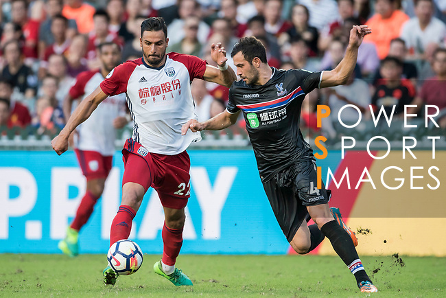 West Bromwich Albion midfielder Nacer Chadli fights for the ball with Crystal Palace midfielder Luka Milivojevic during the Premier League Asia Trophy match between West Bromwich Albion and Crystal Palace at Hong Kong Stadium on 22 July 2017, in Hong Kong, China. Photo by Weixiang Lim / Power Sport Images