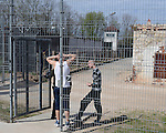 Inmates discuss with guards close to old, soon to be destroyed former prison building, at the Cesu correctional institution of juveniles which has been renovated in one part and newly built in other part, Cesu, May 2013. <br /> <br /> There are 50 inmates at the moment at the correctional institution.